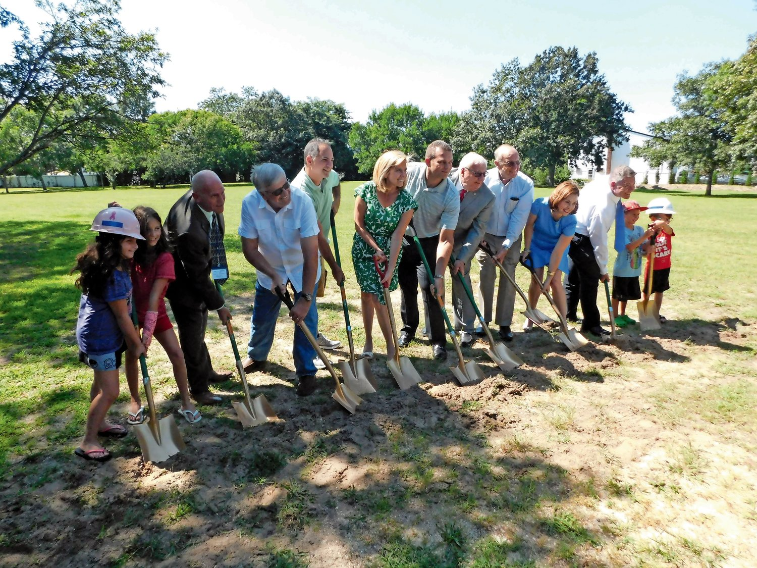 Elected officials and South Merrick Community Civic Association members broke ground on the playground on Aug. 23, 2018.