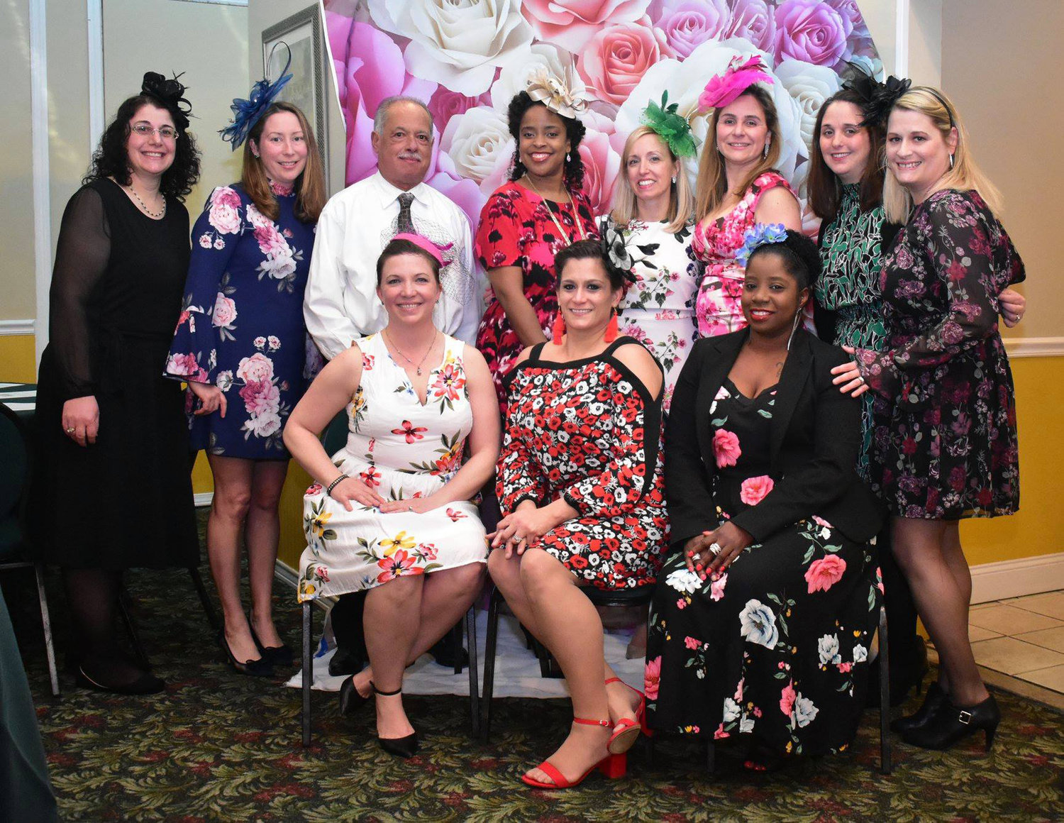 Hayley Kelch, standing fourth from right, coordinated Maurice W. Downing's annual Downing Night Out fundraiser as the group's co-president from 2017 to 2019.