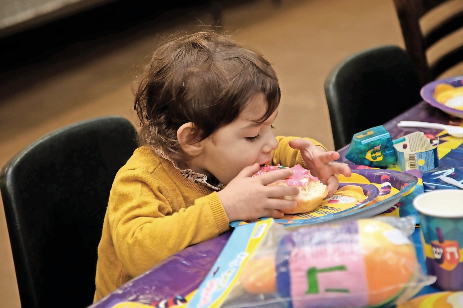 Three-year-old Miriam Ross enjoyed a sweet treat.
