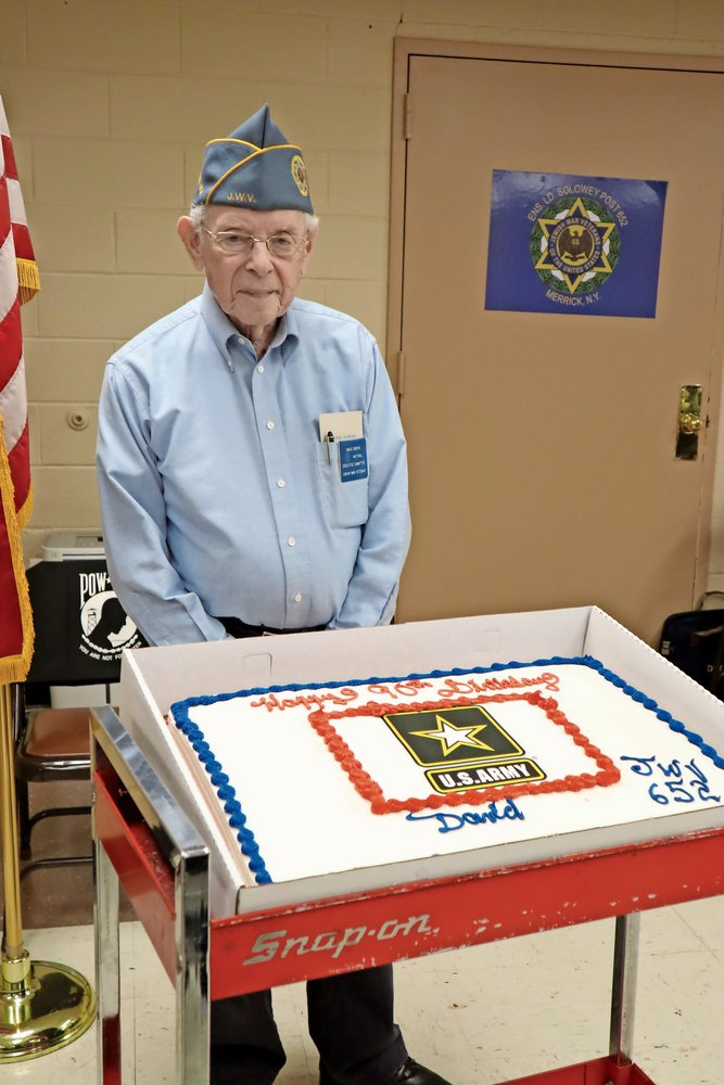 In the basement of Congregation Ohav Shalom, surrounded by his friends in the Jewish War Veterans Post 652, former Commander David Zwerin celebrated his 90th birthday.