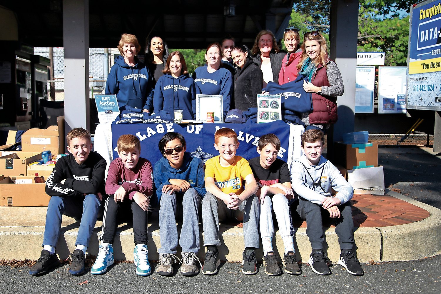 Malverne Civic Association members, and Our Lady of Lourdes seventh-grade volunteers, took part in the organization's annual e-cycling/shredding event on Nov. 2.