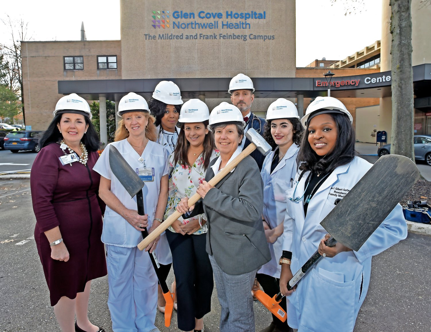 Glen Cove Hospital Executive Director Kerri Anne Scanlon, far left, Dr. Barbara Keber, chair of family medicine at the hospital, center, in gray, and members of the staff gathered in early December to break ground on the hospital's new Family Medicine Center.