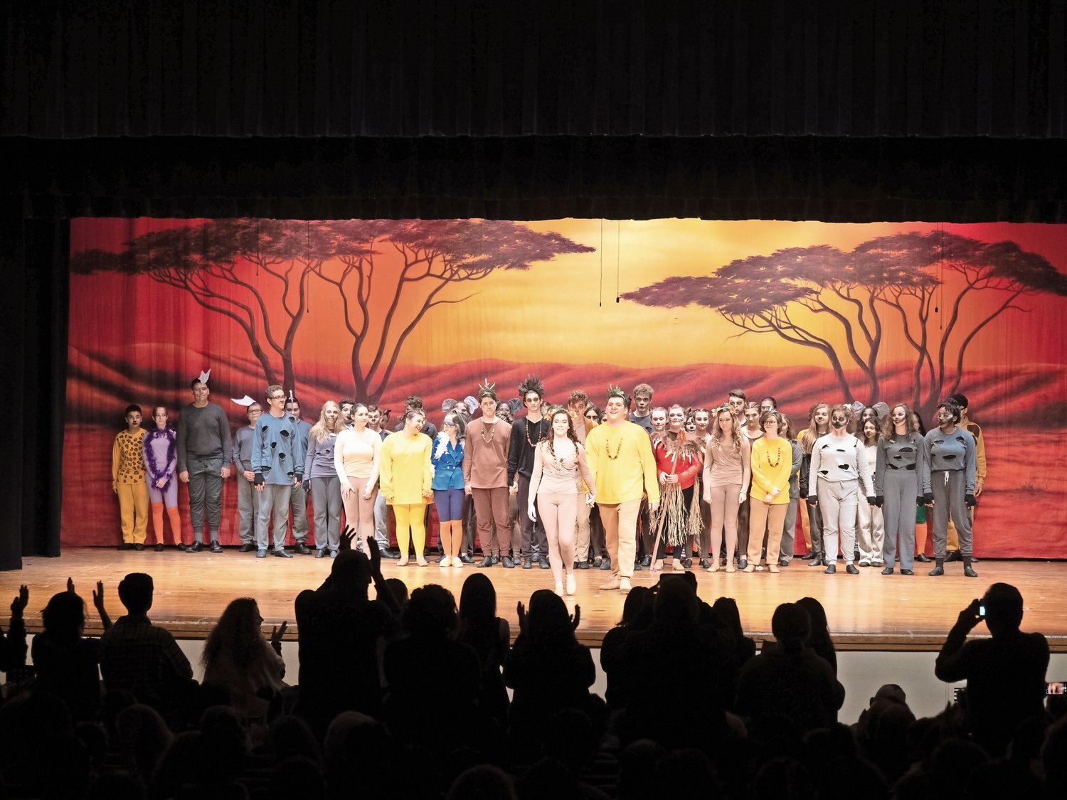 "The entire cast of ""Lion King, Jr."" received a standing ovation after their first performance on Jan. 4 at 7 p.m., top right."