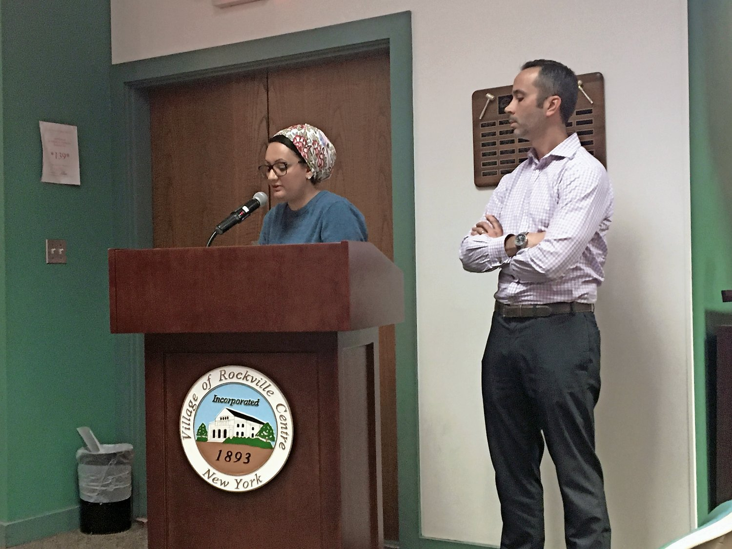 Residents Faria Hassan and Matt Cliszis spoke at the village board meeting.