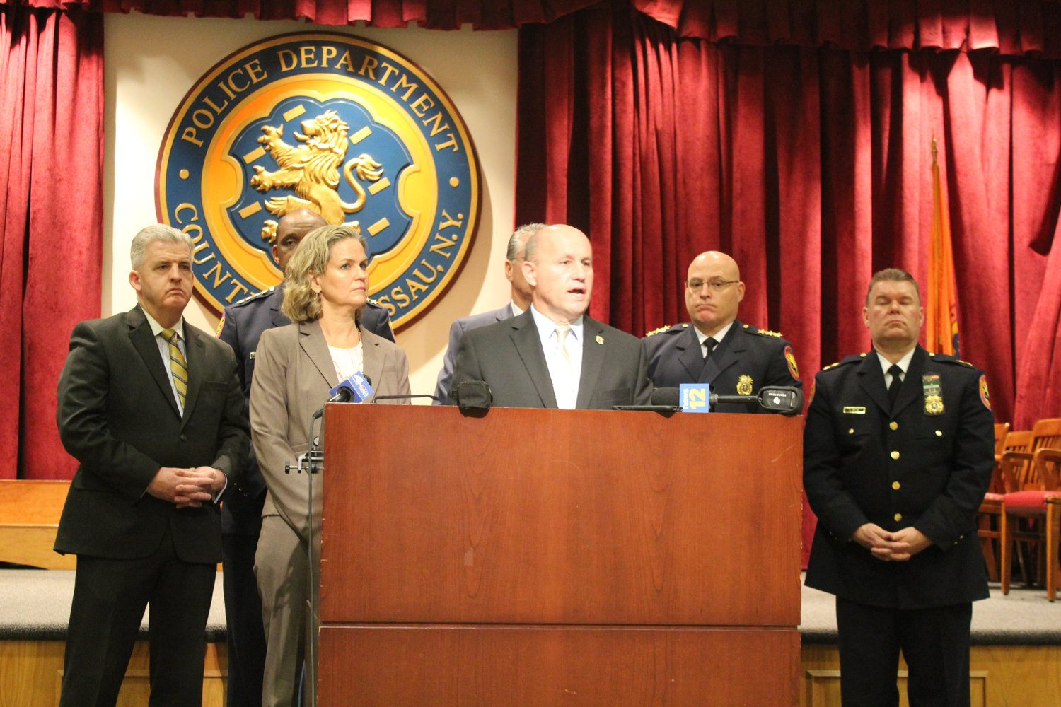 Nassau County Police Commissioner Patrick Ryder outlined drops in crime and announced two new special units at a news conference on Jan. 9. Nassau County Executive Laura Curran is to Ryder's immediate right.
