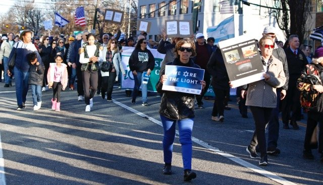 More than 2,000 people marched in MIneola on Jan. 12, to show their support for the Jewish community in the wake of a spate of anti-Semiti attacks in the metropolitan area.