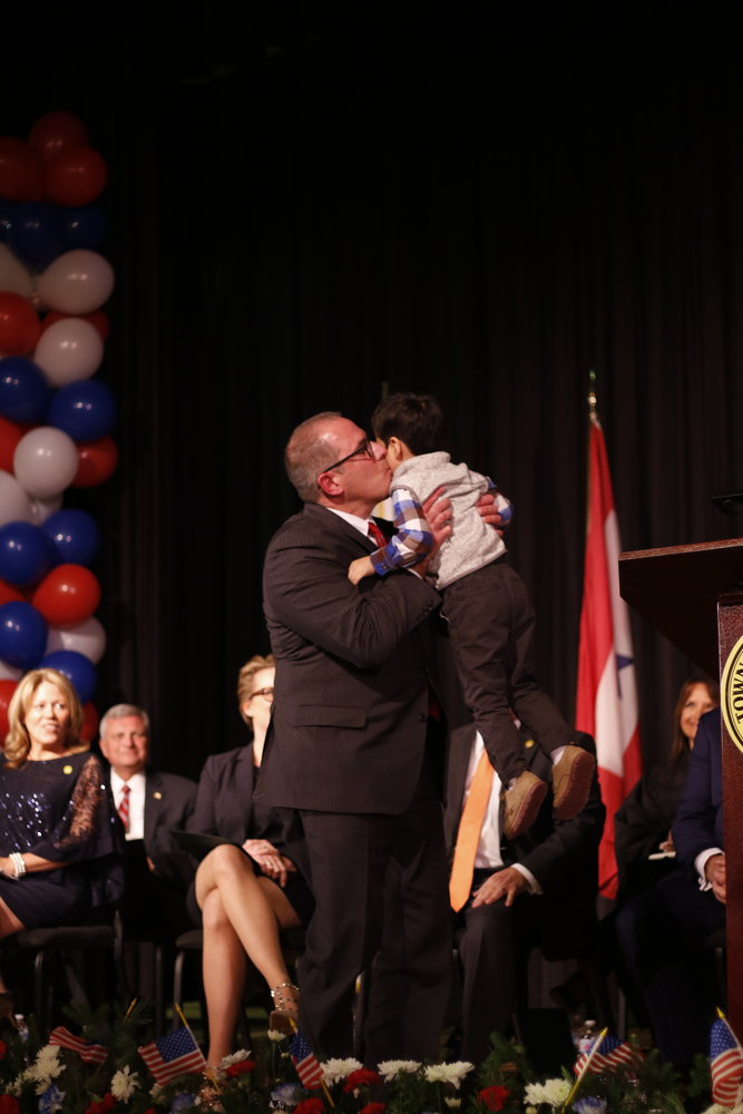 New Town Clerk Richard LaMarca celebrated with his 3-year-old son, Peter.