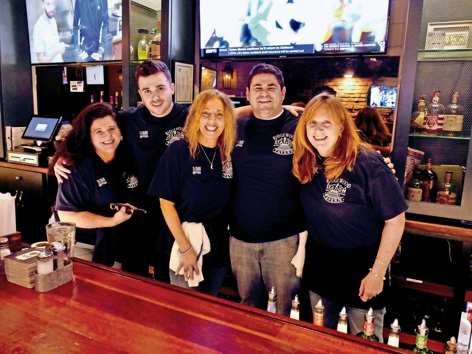 Maureen Conklin, left, Lauren Dupkin Memisha and Liz Greco joined the Ridgewood Tavern bartenders to serve drinks at the Back the Blue fundraiser for widows and families of fallen police officers on Jan. 3.