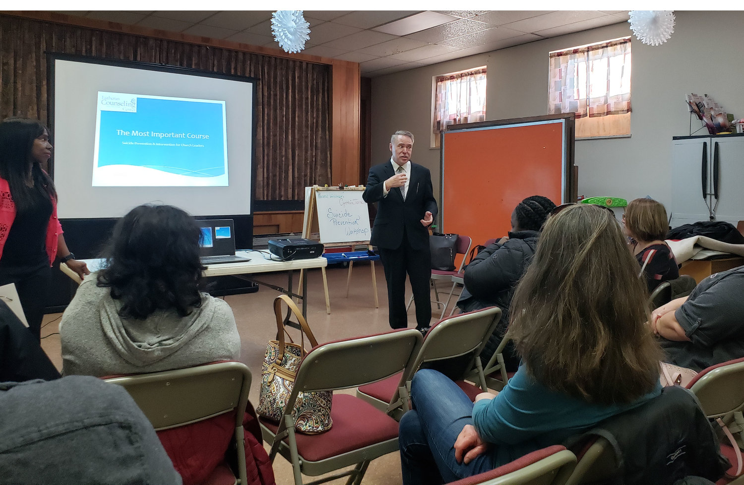Lutheran Counseling Center counselor Forrest Parkinson shared suicide prevention tips during a training session at St. Andrew's Lutheran Church in West Hempstead.