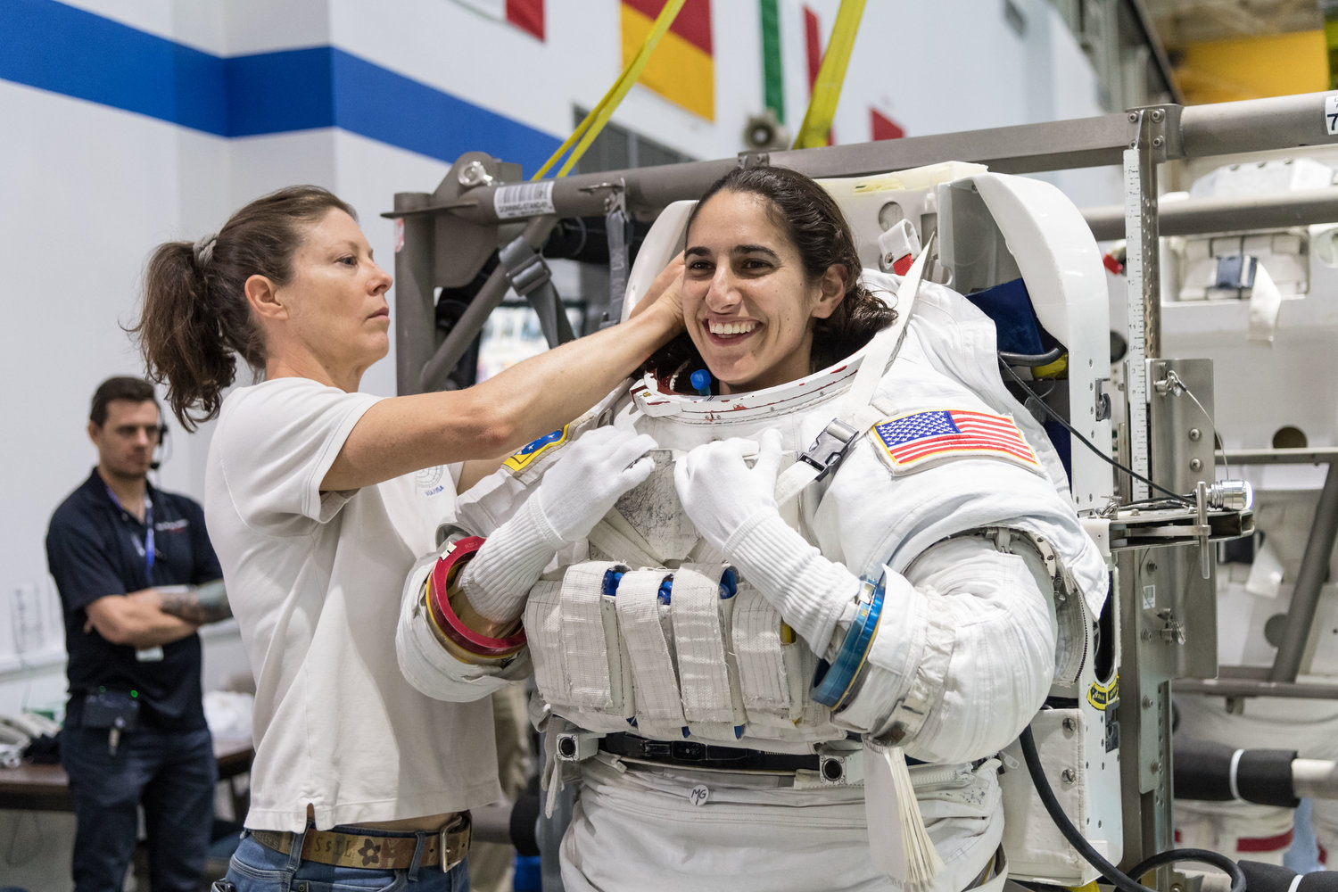 Moghbeli was helped into a spacesuit before underwater spacewalk training at the Johnson Space Center's Neutral Buoyancy Laboratory in Houston.