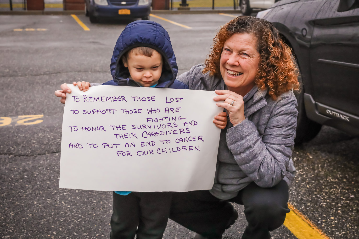 "Meg Dempsey and her grandson, John Thomas Csere, displayed the reasons why they are participating in the ""First Lap"" at Baldwin High School."