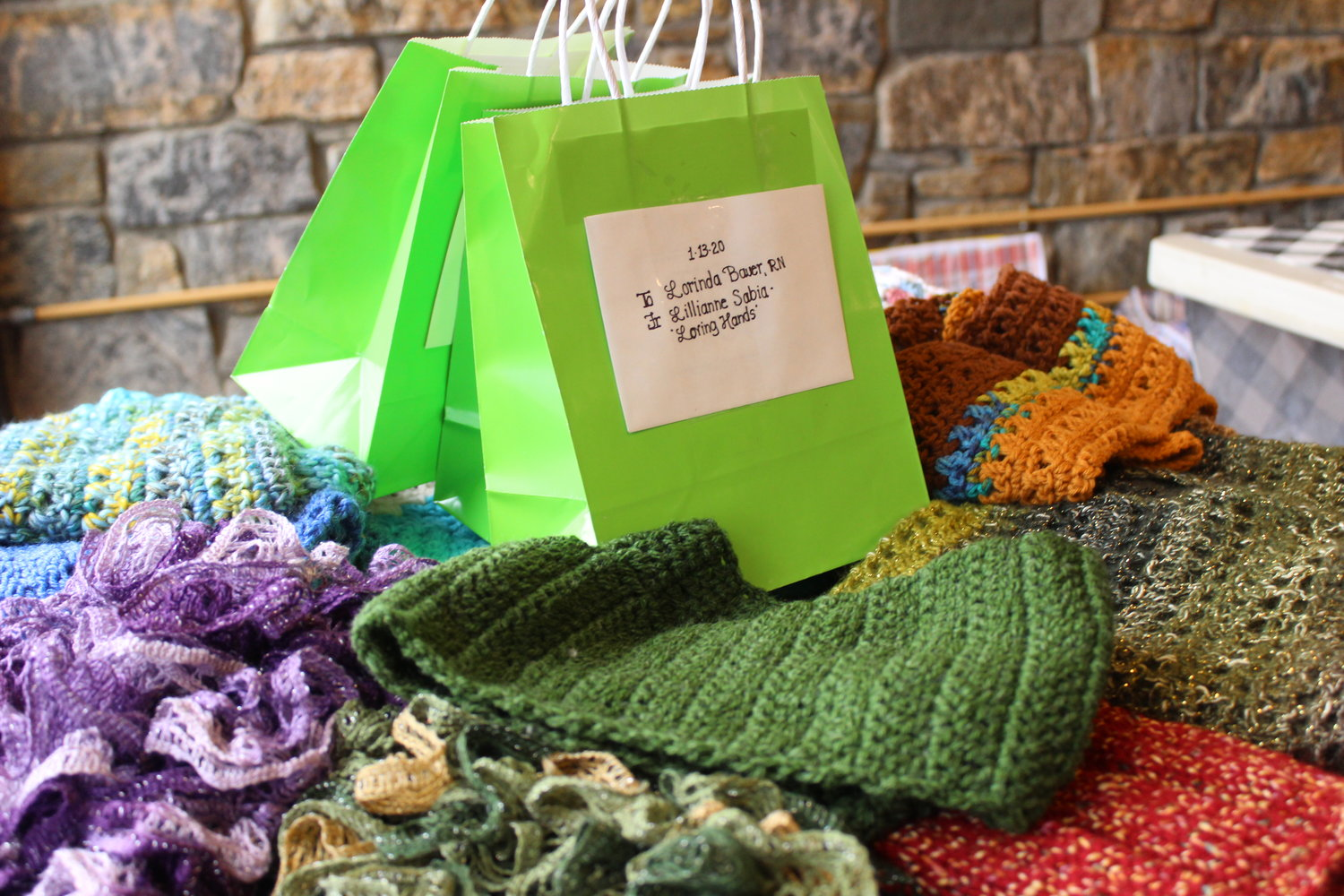 The member of Loving Hands crochet and knit shawls, blankets and other goods that they donate to charities across Long Island.