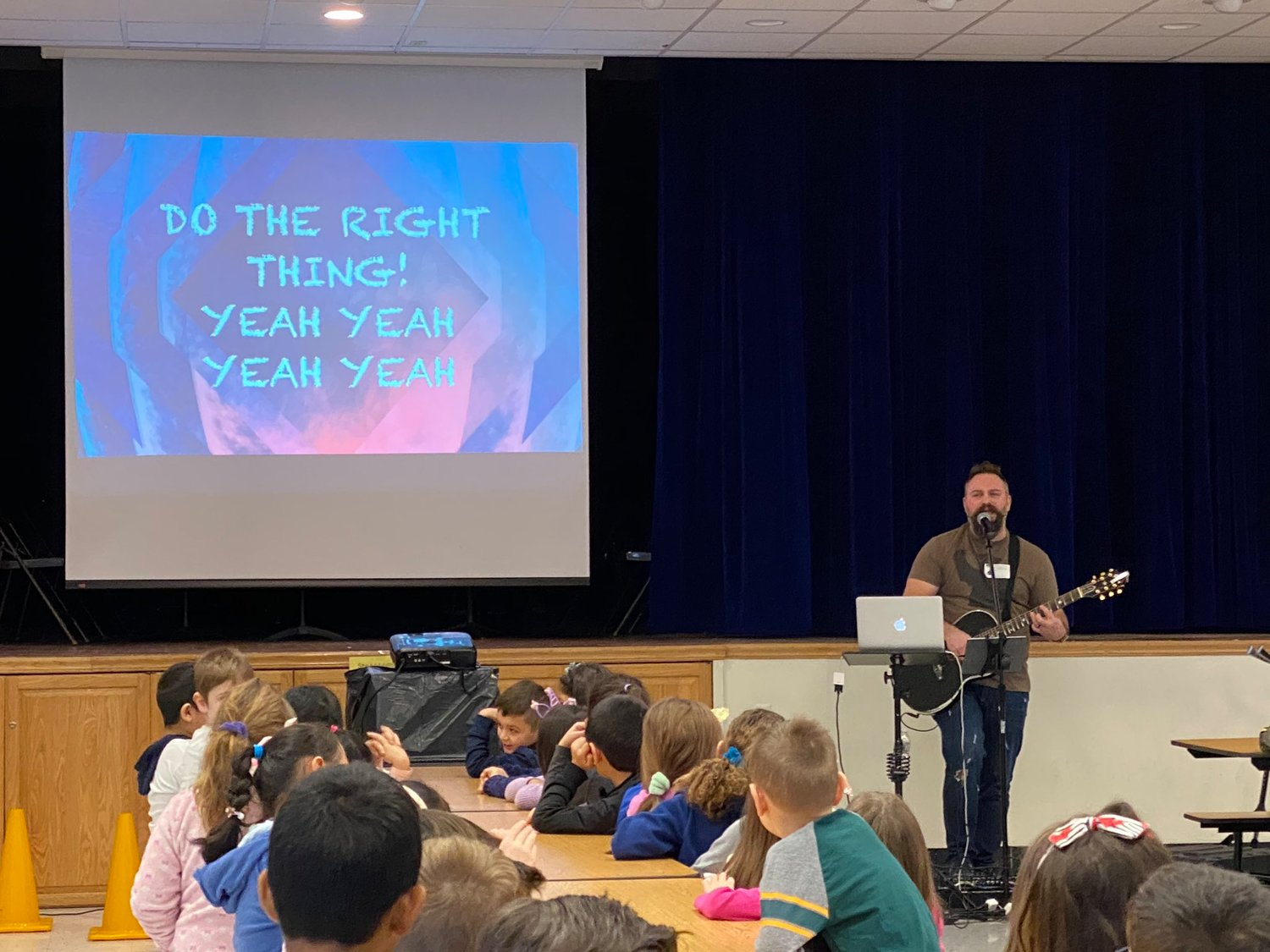 "Pam Tobin's kindergarten class was motivated to wear superhero capes by Jared Campbell's signature song, ""I Want to Be a Superhero,"" during his assembly at Parkway Elementary School on Jan. 9."
