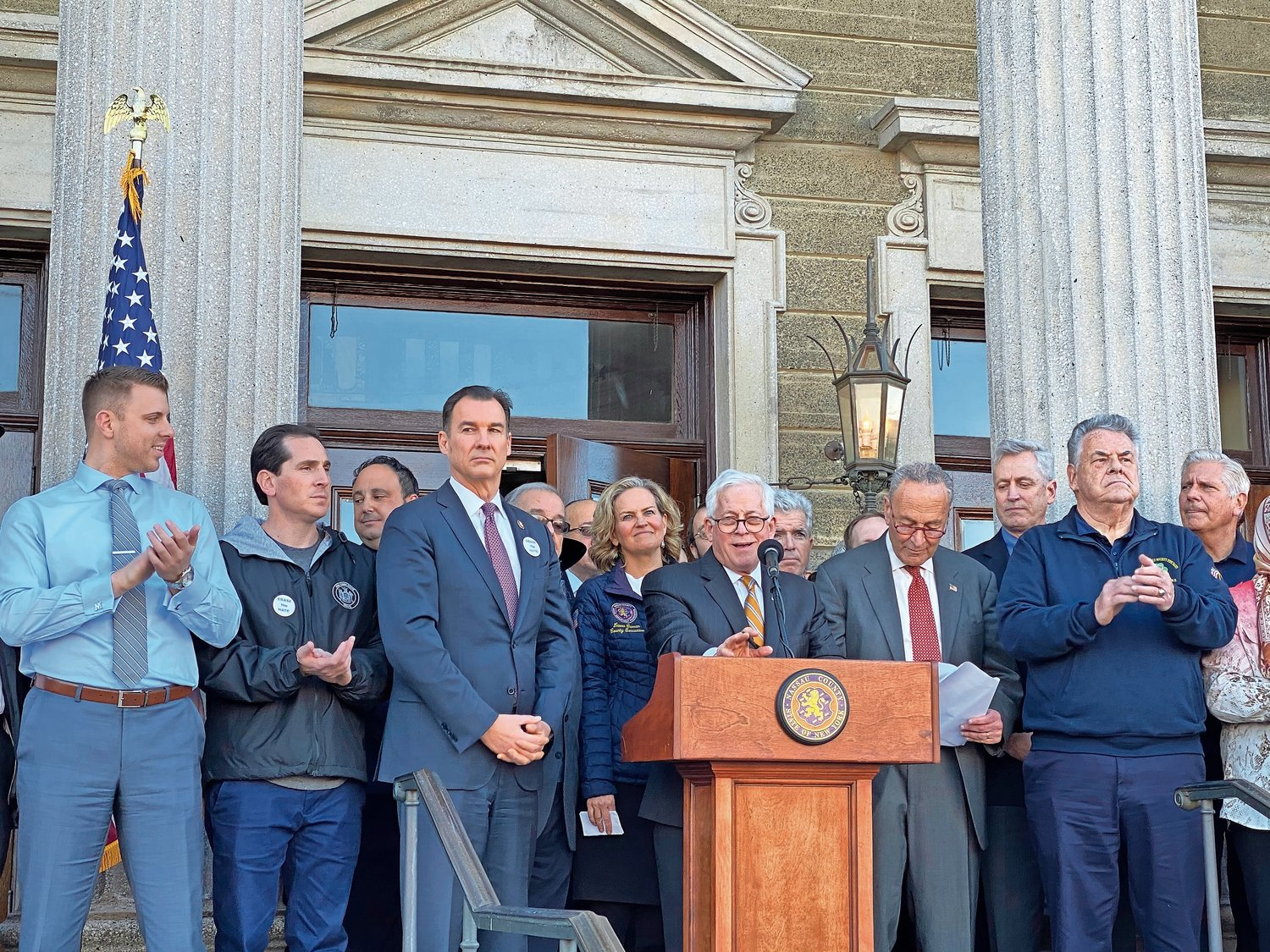 State Assemblyman Charles Lavine, at the lecturn, condemned anti-Semitism along with U.S. Rep. Tom Suozzi, left, County Executive Laura Curran and U.S. Senator Chuck Schumer at a march against hate.