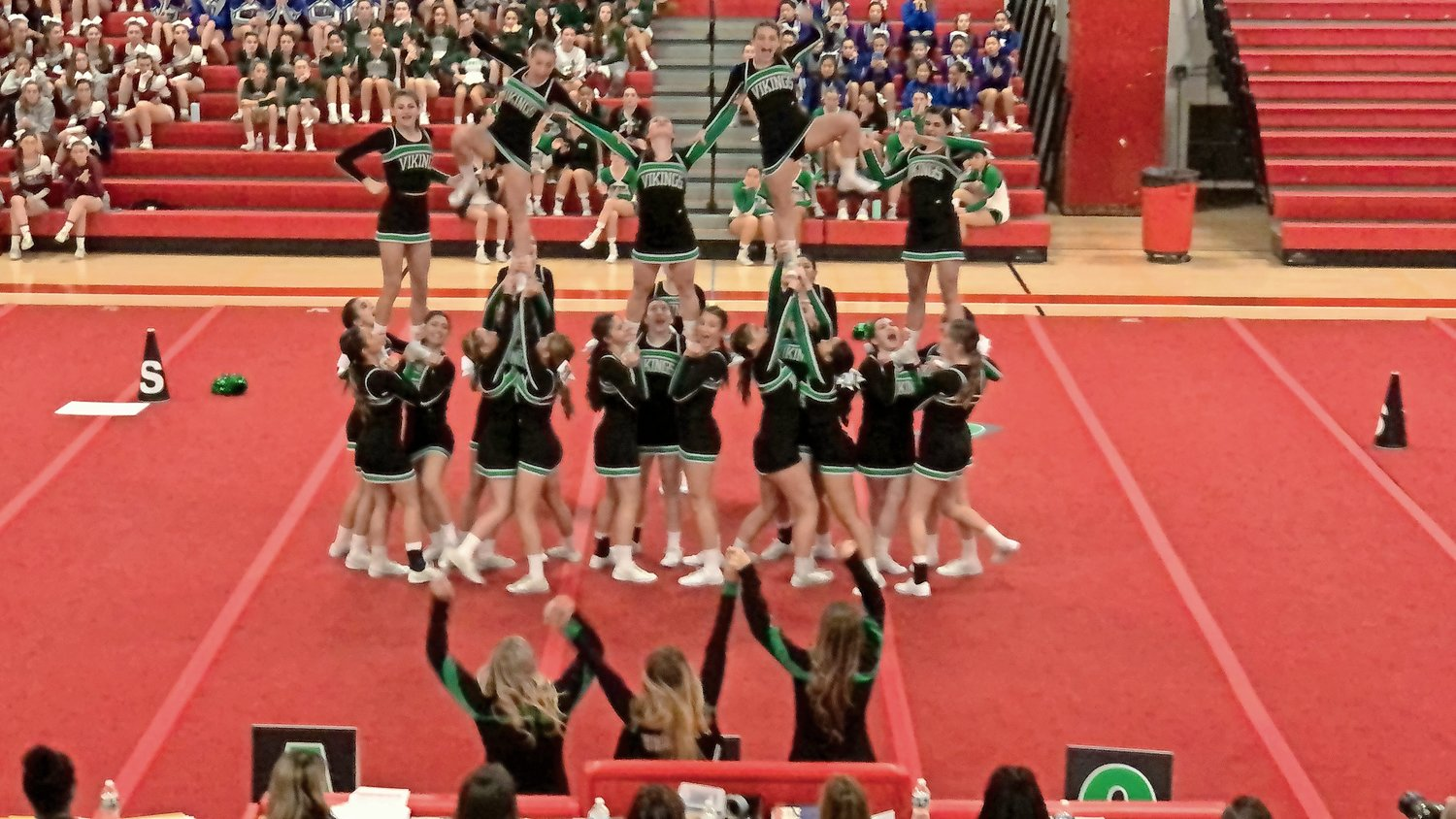 "Head coach Lisa Ferrari and a team of talented athletes have created a routine full of ""super elite"" stunts that earn lots of points."