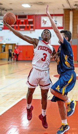 Freeport's Danyel St. Louis, left, drove to the rim during the Red Devils' come-from-behind 54-51 victory over Massapequa on Jan. 14.