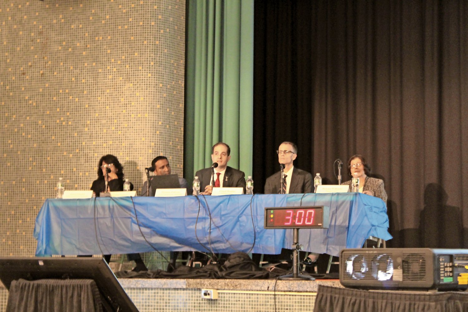 The panel of LIPA and county officials, top, comprised, from left, Anna Chacko, general counsel of LIPA; Sid Nathan, the utility's communications director; Tom Falcone, its CEO; Conal Denion, of the Nassau County attorney's office; and Helena Williams, chief deputy county executive.