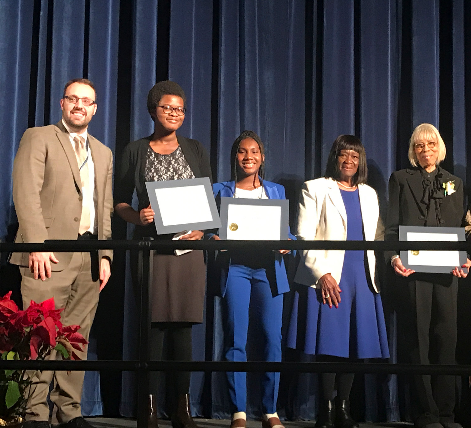 Baldwin students Reyna Palmer, second from left, and Moni Aderemi were presented with the Humanitarian Award, joined by Baldwin High School Principal Dr. Neil Testa, Hempstead Town Councilwoman Dorothy Goosby and Concerned Parents of Baldwin member Sharon Ball.