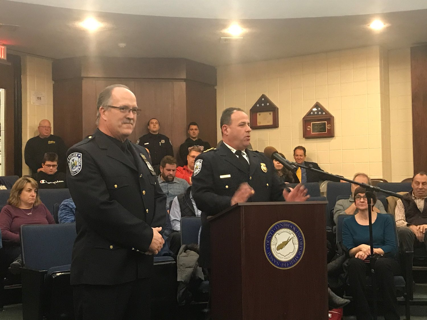 Police Chief Brian Paladino, right, expressed his gratitude to Hahl for his dedication.