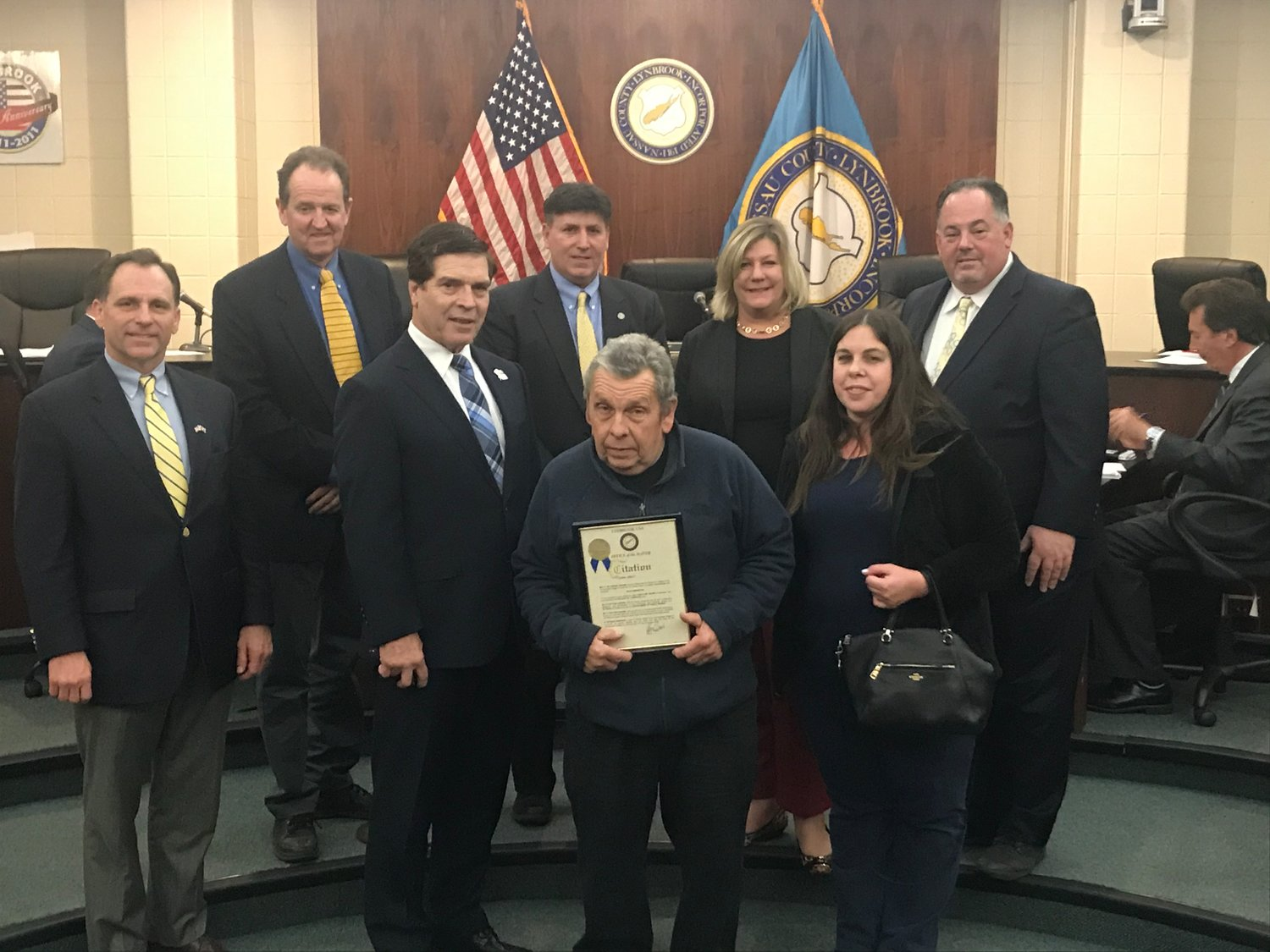 Department of Public Works employee Pat Brewster, center, was also honored upon his retirement after serving the village for 36 years.