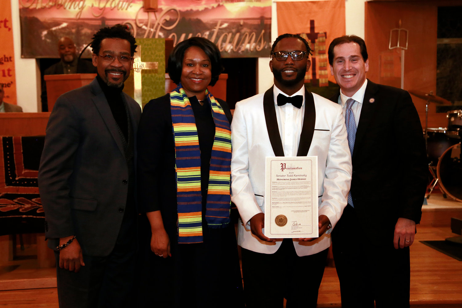 The Rev. Tyrone Cook of the Powerhouse COGIC in Merrick, from left, Clemons-Jones, Honoree James Hodge of the Long Beach MLK Center and State Sen. Todd Kaminsky.