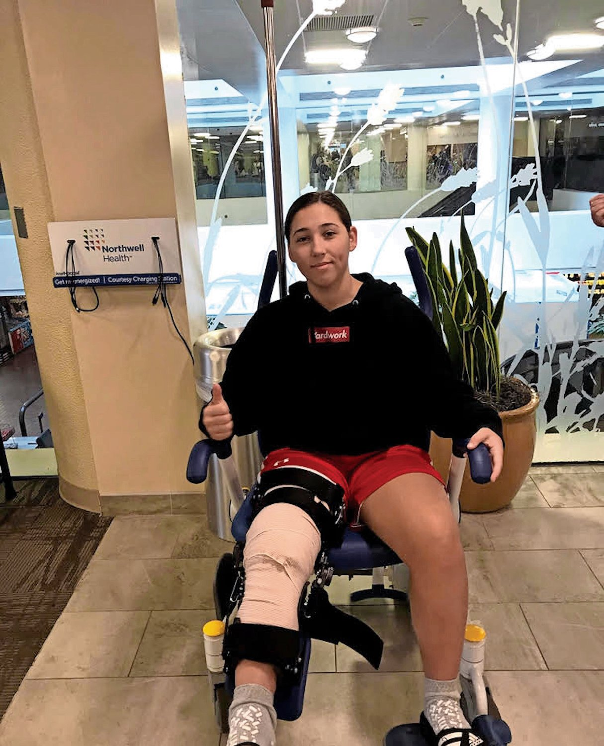 Days after her second surgery, Dellacroce stretched her leg in a wheelchair.
