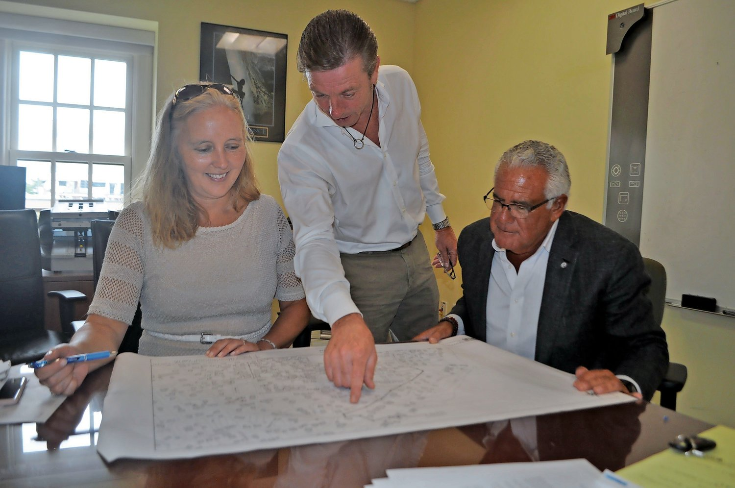 Nassau County Legislator Delia DeRiggi-Whitton, Sea Cliff Village Administrator Bruce Kennedy, center, and Sea Cliff Mayor Edward Lieberman have spent much of the last year and a half reviewing plans for Sea Cliff's sewers.