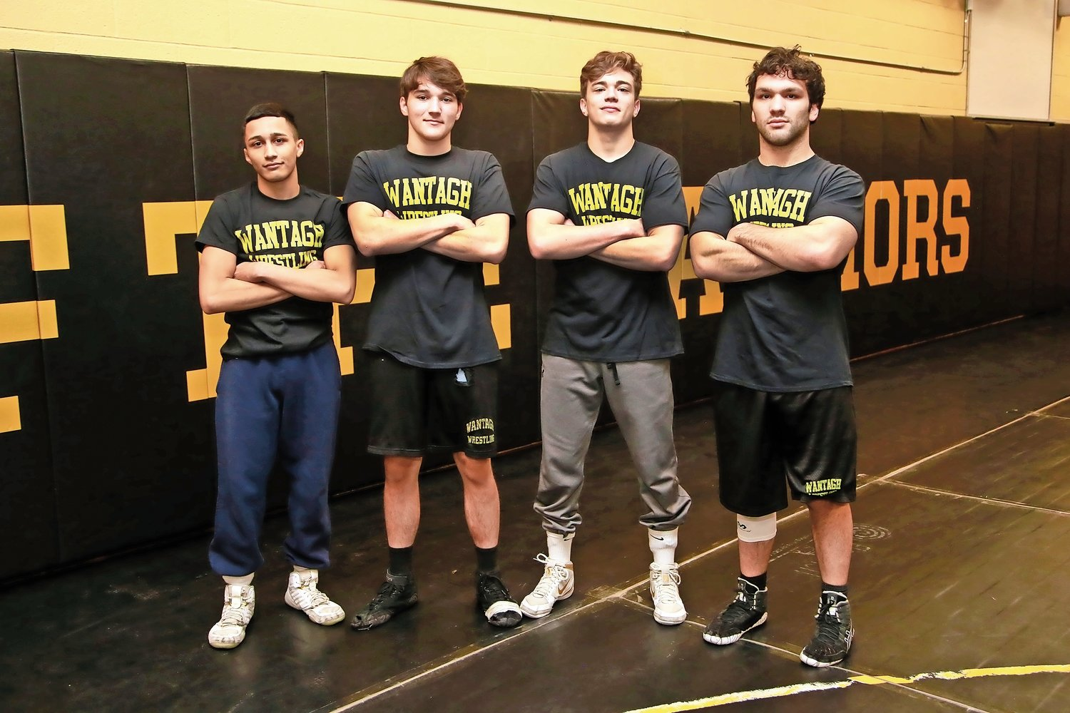 Josiah Encarnacion (120 pounds), far left, Anthony Grogan (170), Joseph Russo (152) and Matt Rogers (182) are the senior captains who led the Warriors wrestling team to an undefeated season.