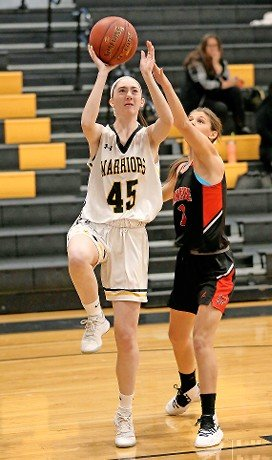 Morgan Flaherty, left, who helped the Lady Warriors to the Nassau Class A finals last season, has been a strong contributor again averaging 12.5 points per game.
