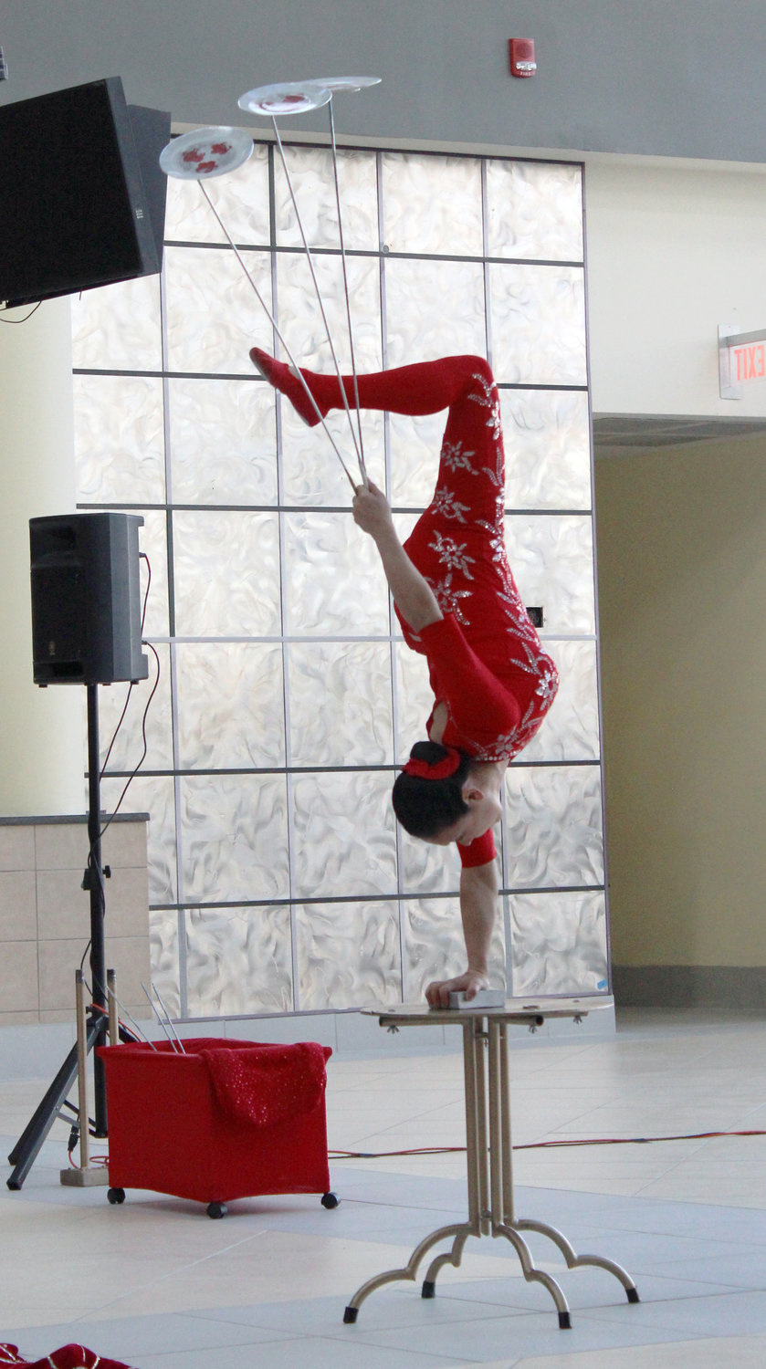 Chinese acrobat Li Liu performed for patrons of the East Meadow Public Library on Jan. 26 at the Samanea New York Market, formerly the Source Mall in Westbury.