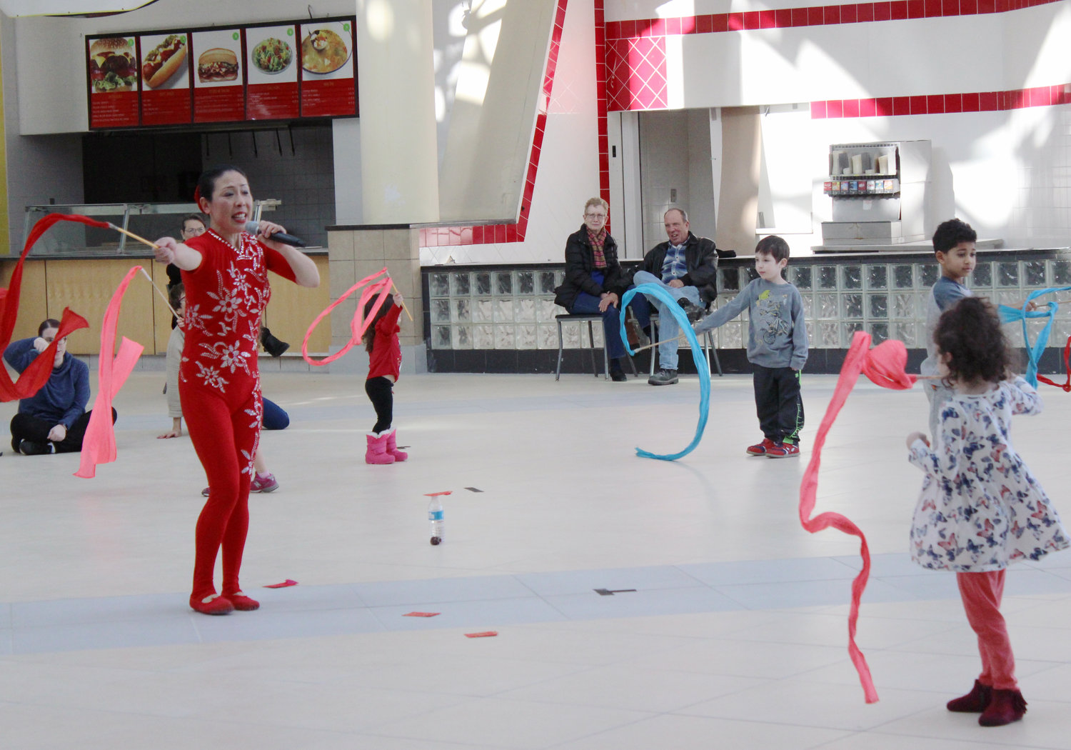 A group of children in attendance were able to test out their ribbon dancing skills under the direction of Li Liu.