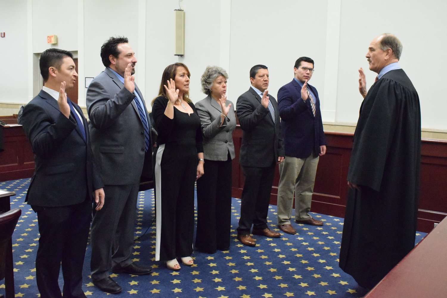Glen Cove City Court Judge Richard McCord swore in members of the board of directors of the North Shore Hispanic Chamber of Commerce of New York, from left, Ever Padilla, Steve Pavlidis, Soraida Corella, Lucy Notaro, Bolivar Corella and Marlon Maldonado.