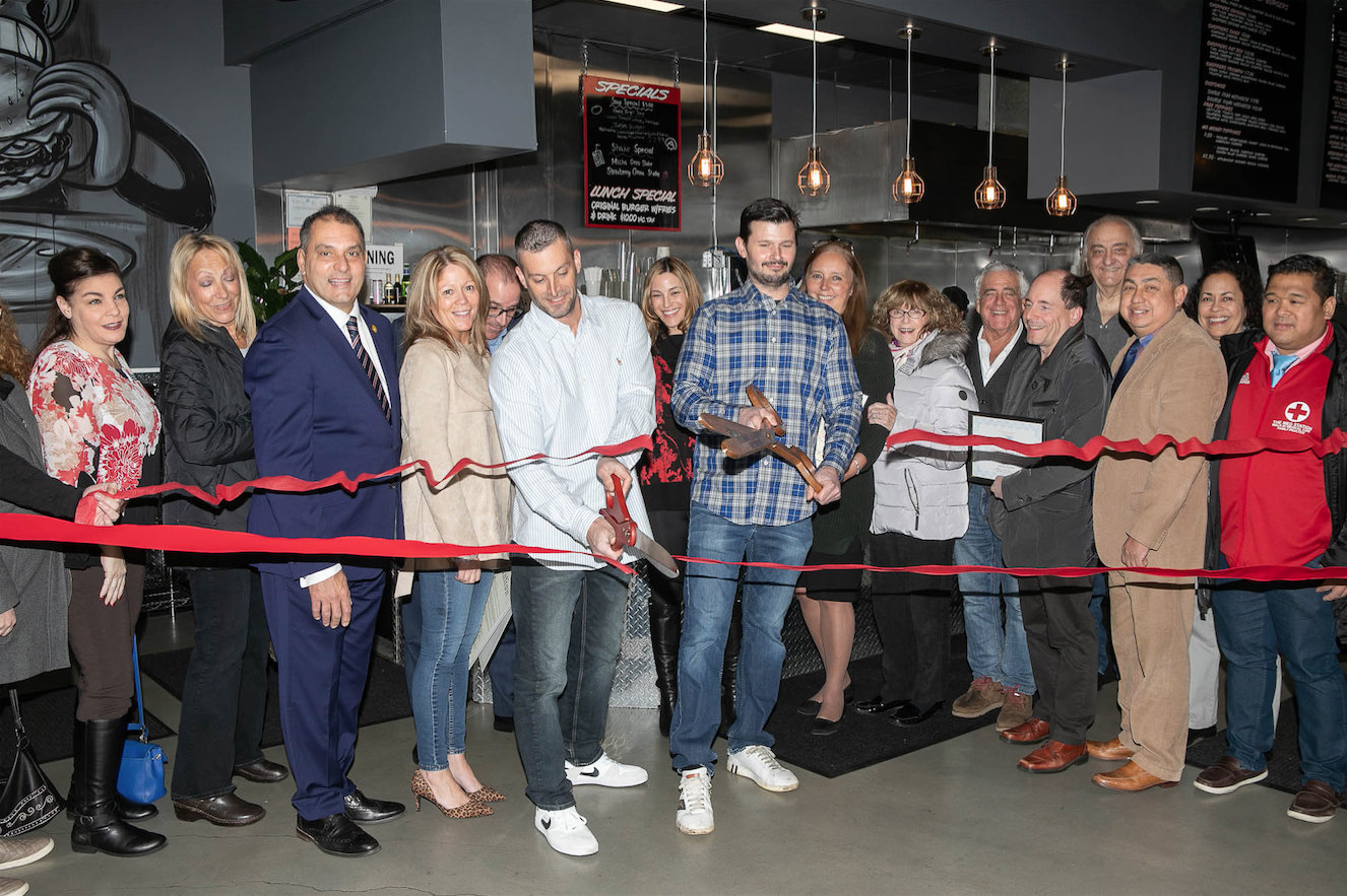 Nick Litterello and Kent Monkan, center left and right, celebrated the grand opening of Choppers with local and county officials.