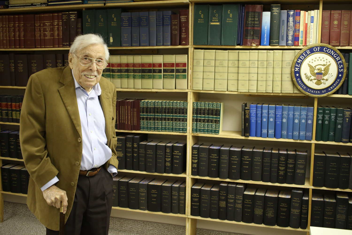 Lester Wolff has an extensive library in his East Norwich home that includes several books he wrote. He said he was honored that President Trump signed a law renaming the North Shore refuge the Congressman Lester Wolff Oyster Bay National Wildlife Refuge.