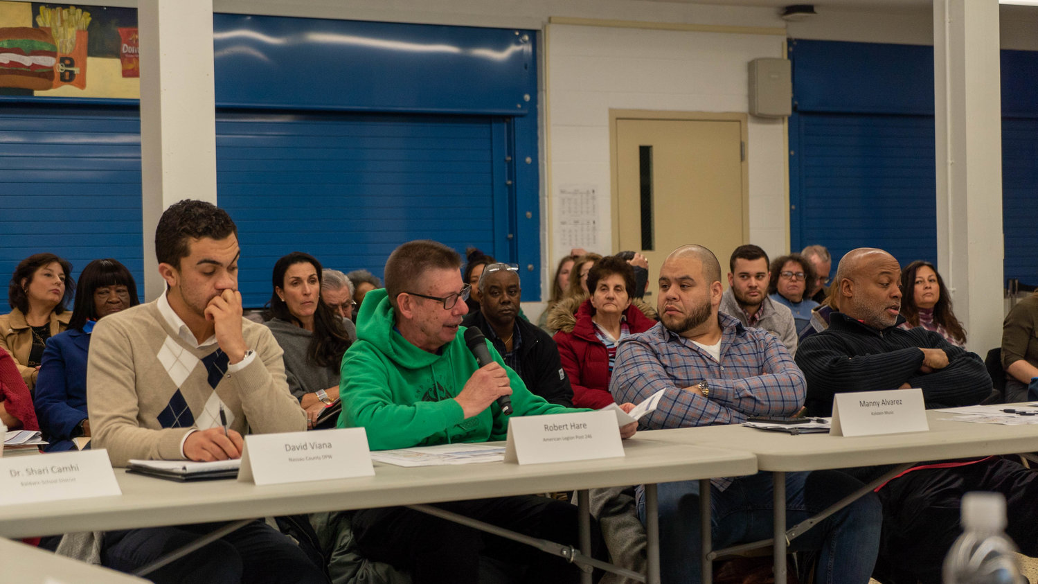 Baldwin American Legion Commander Bob Hare, center, asked about housing projects at the latest Baldwin Downtown Revitalization Initiative meeting on Jan. 29.