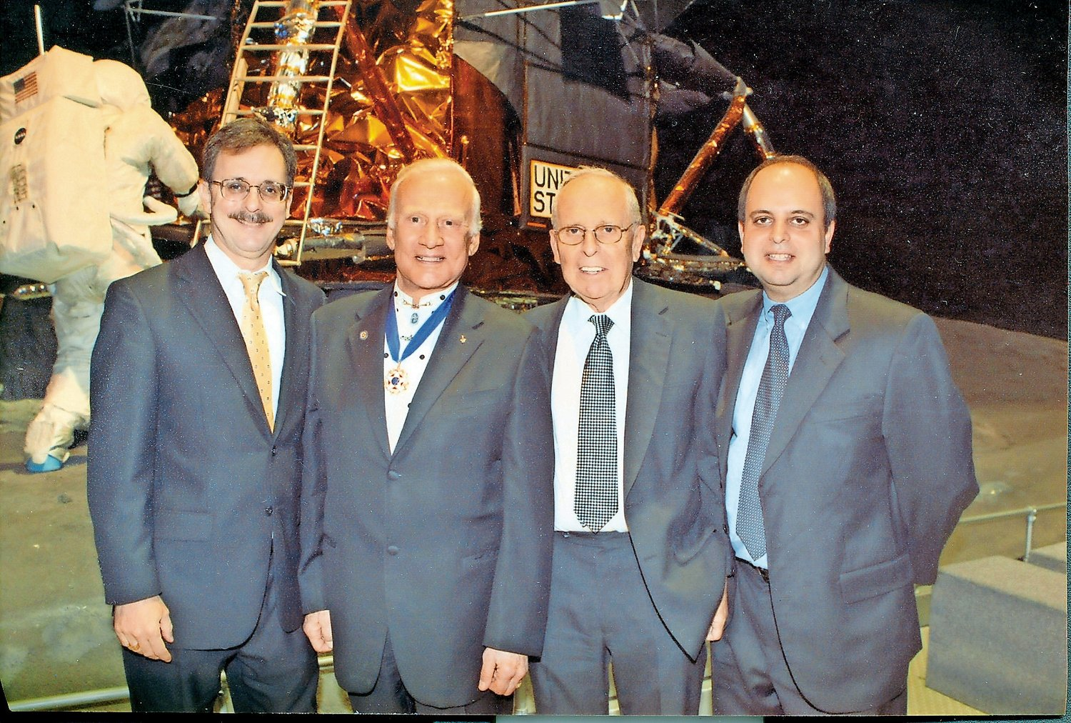 Botwin, second from right, in front of the Cradle of Aviation's Lunar Module with Buzz Aldrin, second from left, and Botwin's sons, Brad, far left, and Neil.