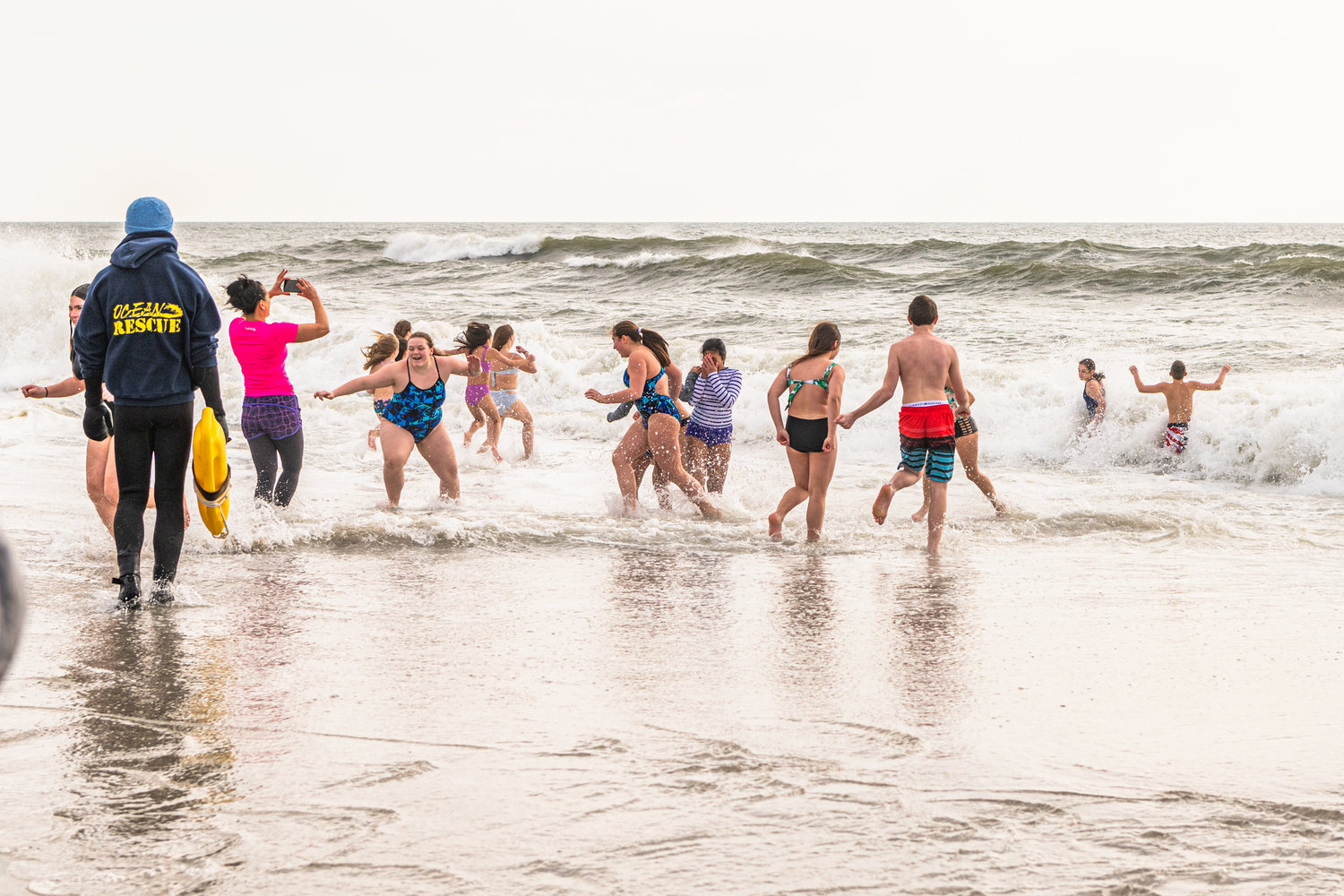 Brave swimmers ran into the water with friends and family recording the moments.