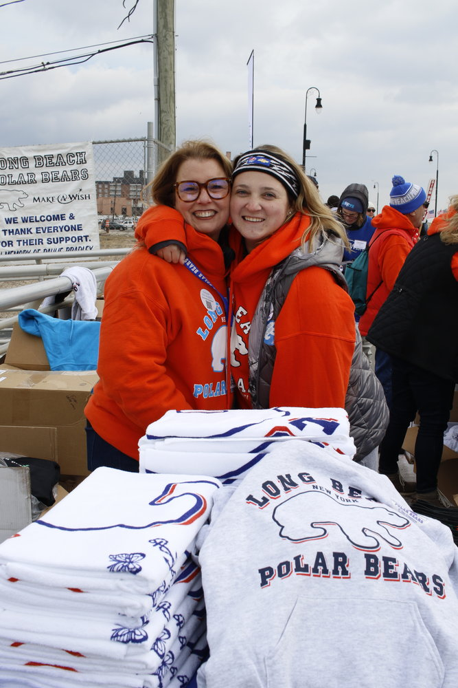Longtime volunteers Nadine Rizzo, left, and Jackie Gruber sold sweatshirts and other merchandise.