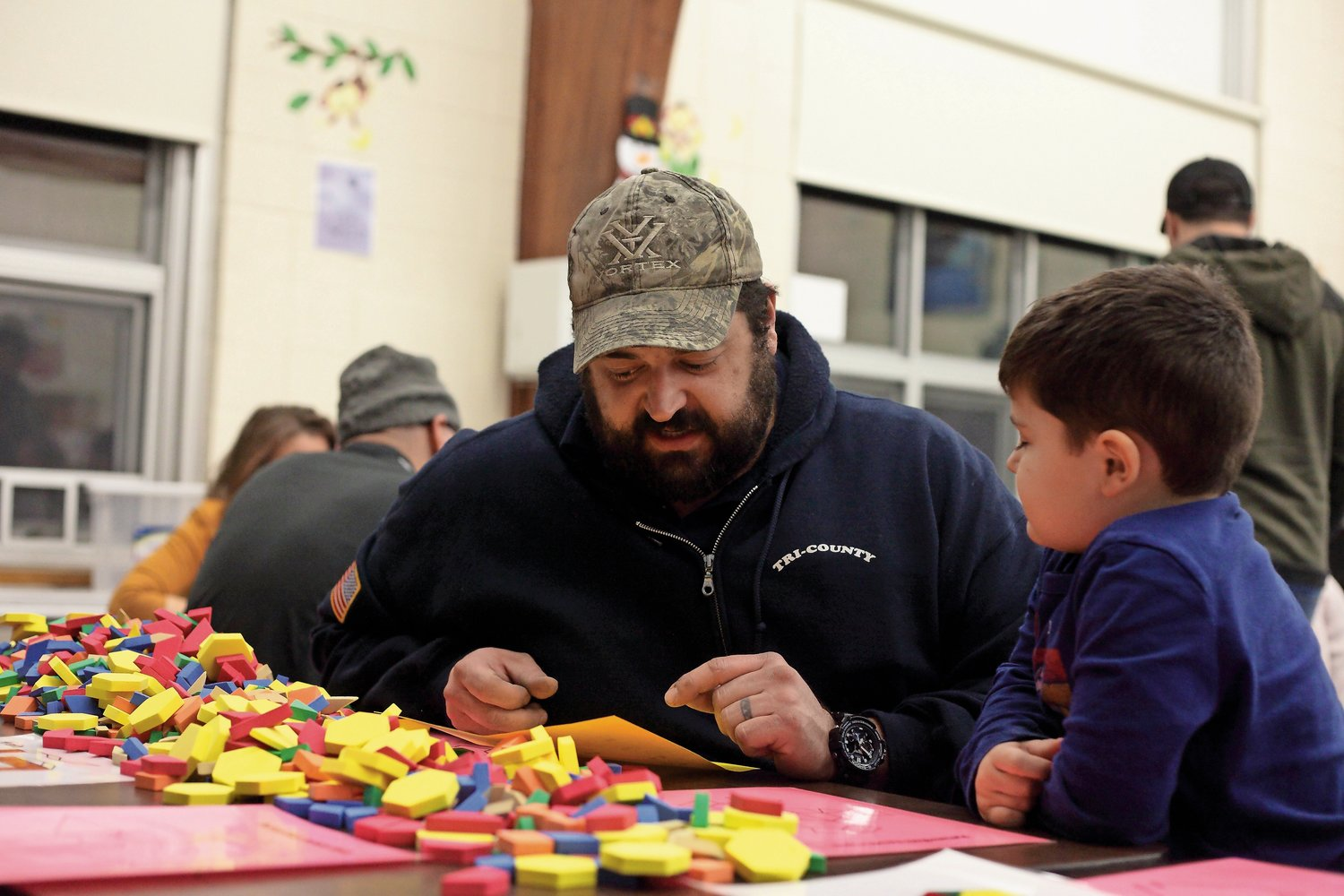 Mike Carfora and his son, Everett, 4, enjoyed a variety of hands-on math and English language building activities.