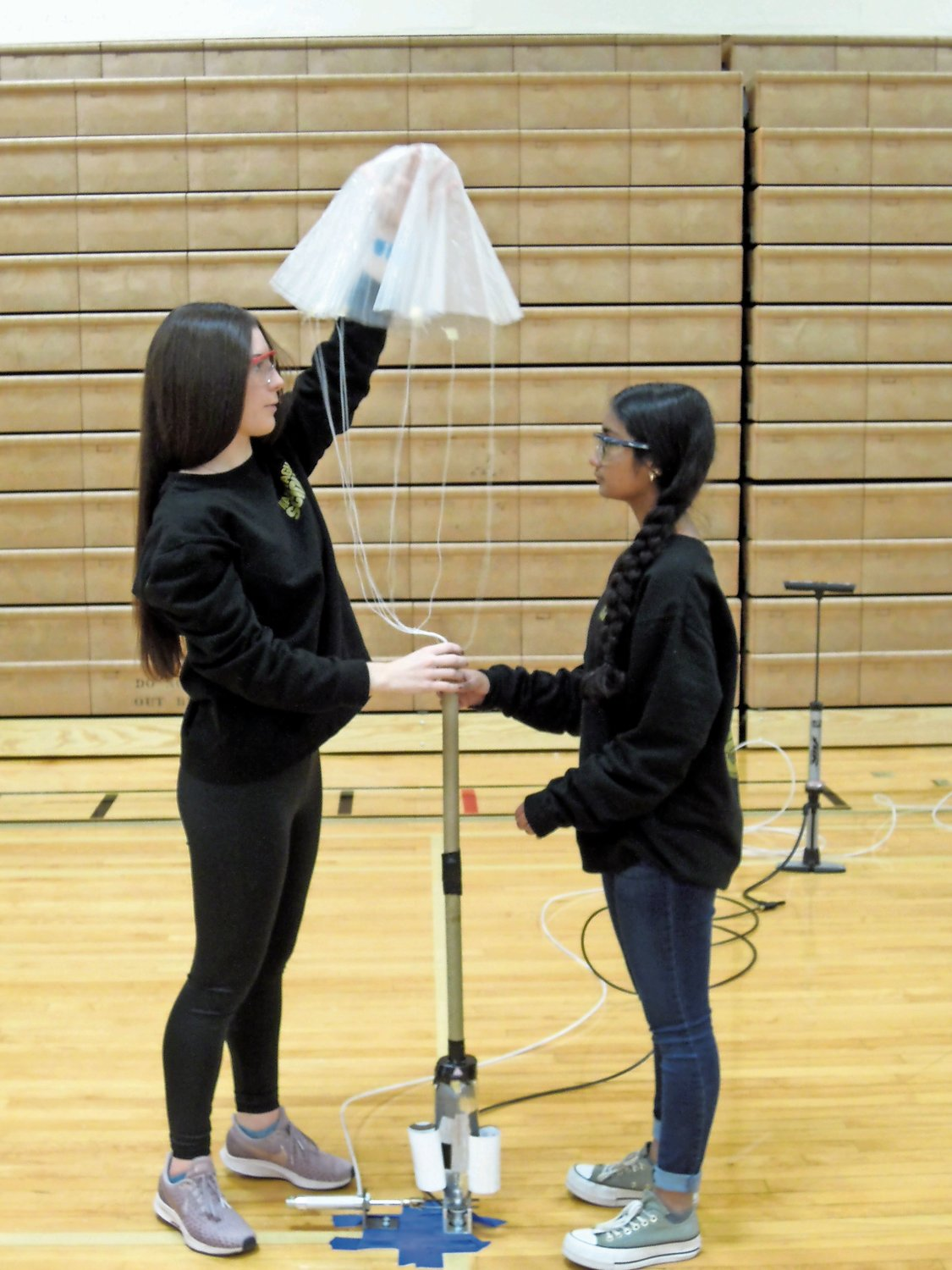 Wantagh's ping pong parachute team of Margaret Gates, far left, Abigail Colaeo and Athena Yao (not shown) prepared their bottle rocket for launch.