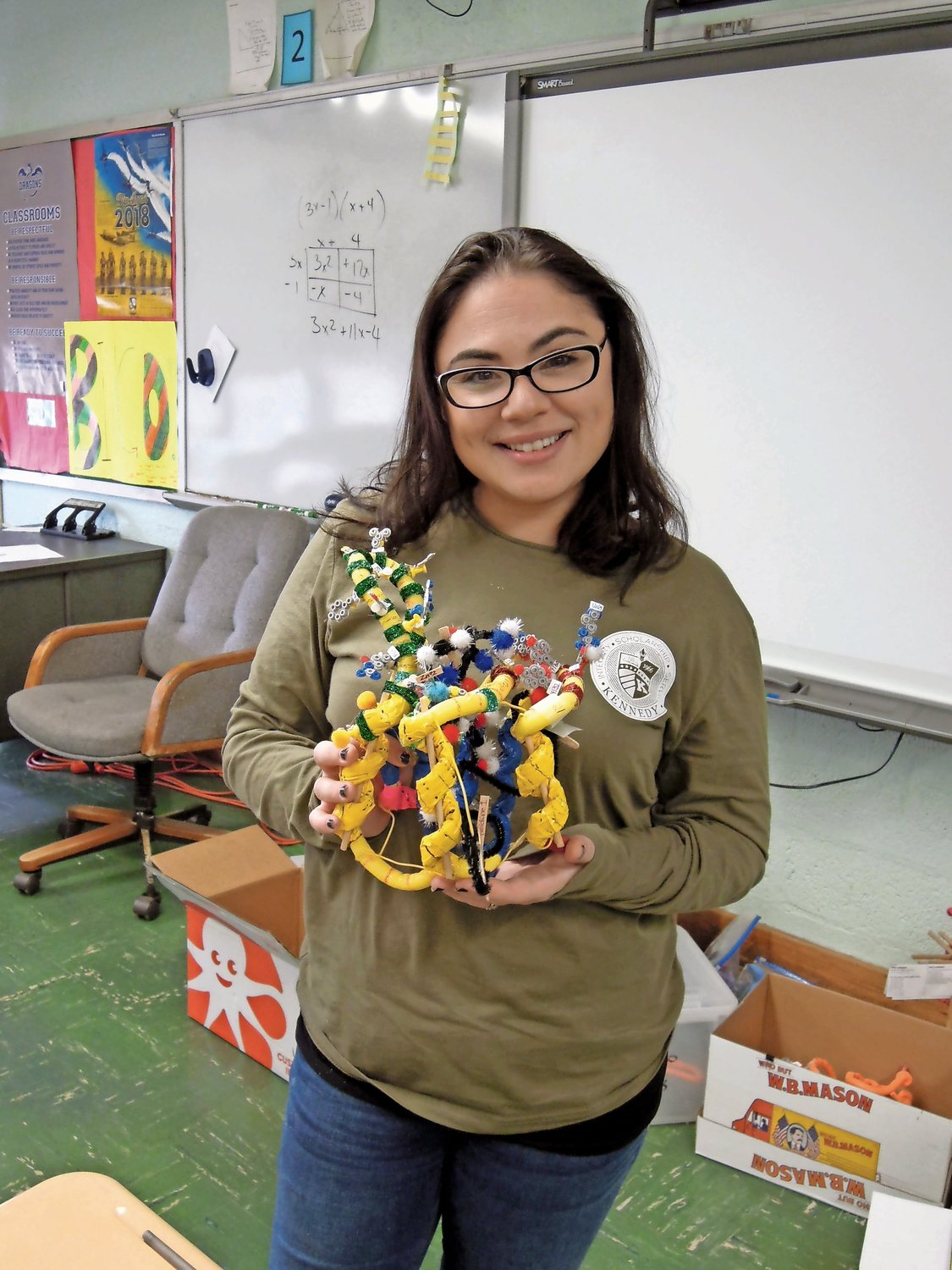 Kennedy High School coach and science teacher Alexis Vandergoot, near left, with her version of the finished molecule in the protein modeling event.