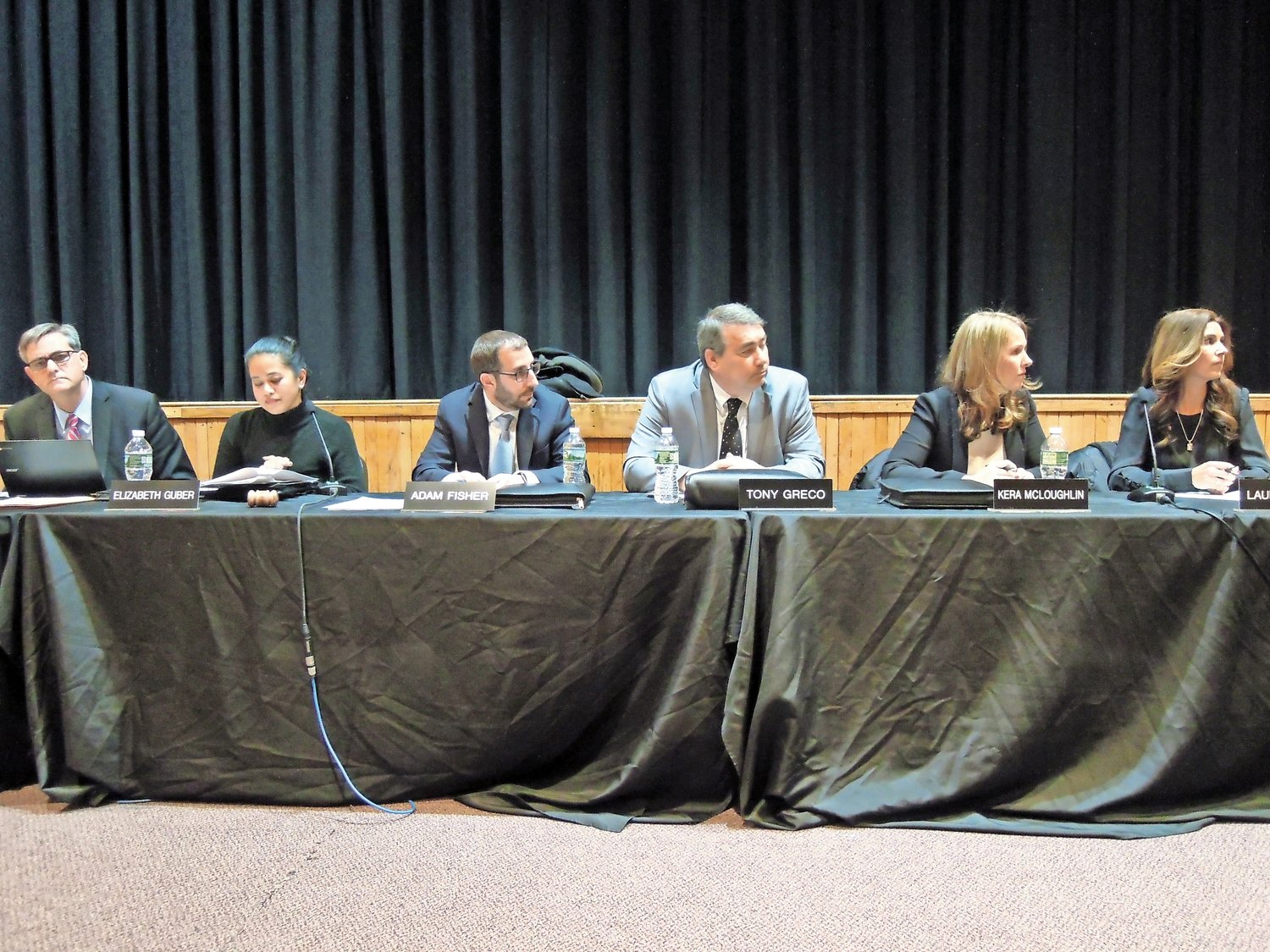 From left, district Superintendent John McNamara, Guber, Vice President Adam Fisher, and trustees Tony Greco, Kera McLoughlin and Laura Reich listen to public comments on the transfer at the Dec. 12 board meeting.
