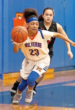 Malverne's Tamaira Smalls turned upcourt with East Rockaway's Mimi Bilardello on her heels during the Lady Mules' 26-18 victory on Feb. 4.