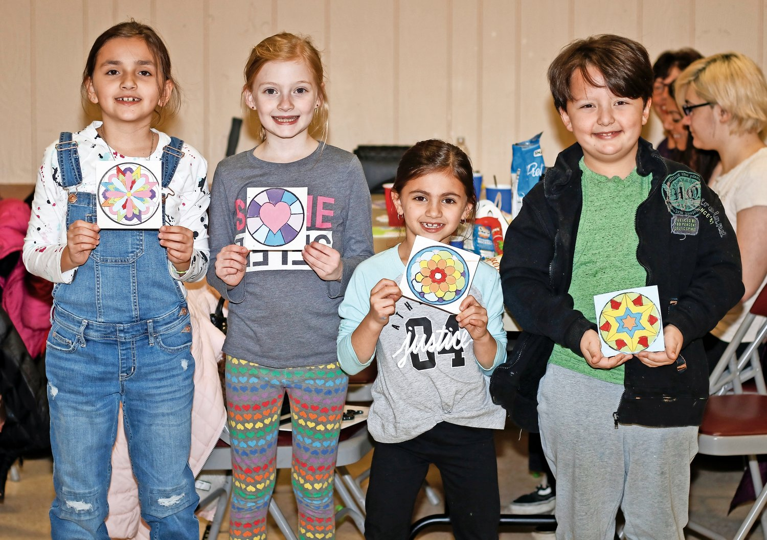Ava Ventura, 8; left, Madison Duckworth, 8; Kylee Lanci, 7; and Mason Otero, 8, showed off the paintings they created.