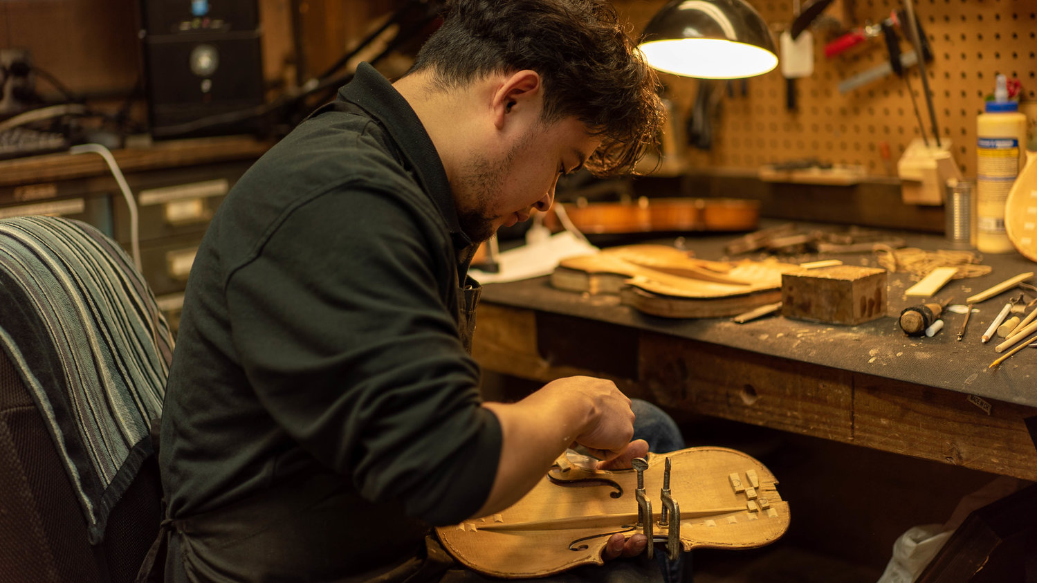 Rigo Dubon worked on a violin in the shop.