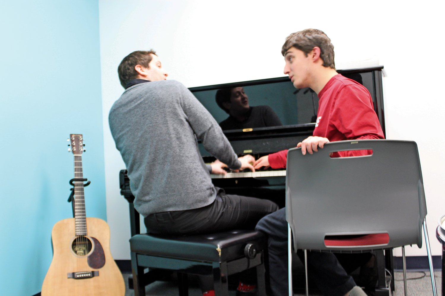 Music therapist Michael Kelliher, left, sang with client Christopher Troiano.