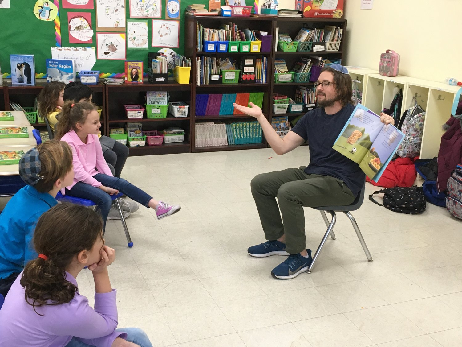 In an effort to bring World Read Aloud Day to school, Hindi's Libraries co-founders Leslie Gang and Dovid Kanarfogel visited seven classrooms at The Brandeis School on Feb. 5. Kanarfogel read 'Peanut Butter & Cupcake' by Terry Border to Helen Liebman's second-grade class.