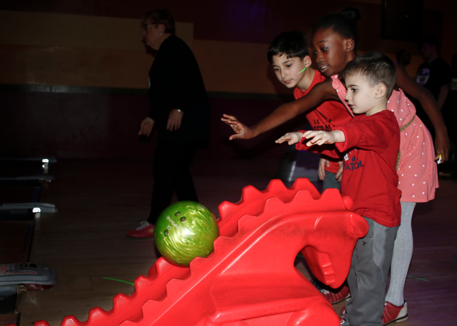 Adrian Baharvar, 8, right, rolled a spare with help from his brother Elliot, 8 and Soriah Gift, 8.