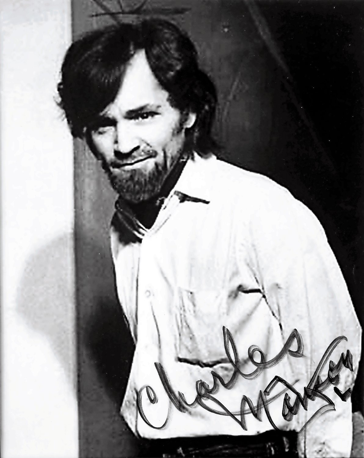 Aside from the letters, doodles and hair from Charles Manson, the collection also includes an autographed photo.