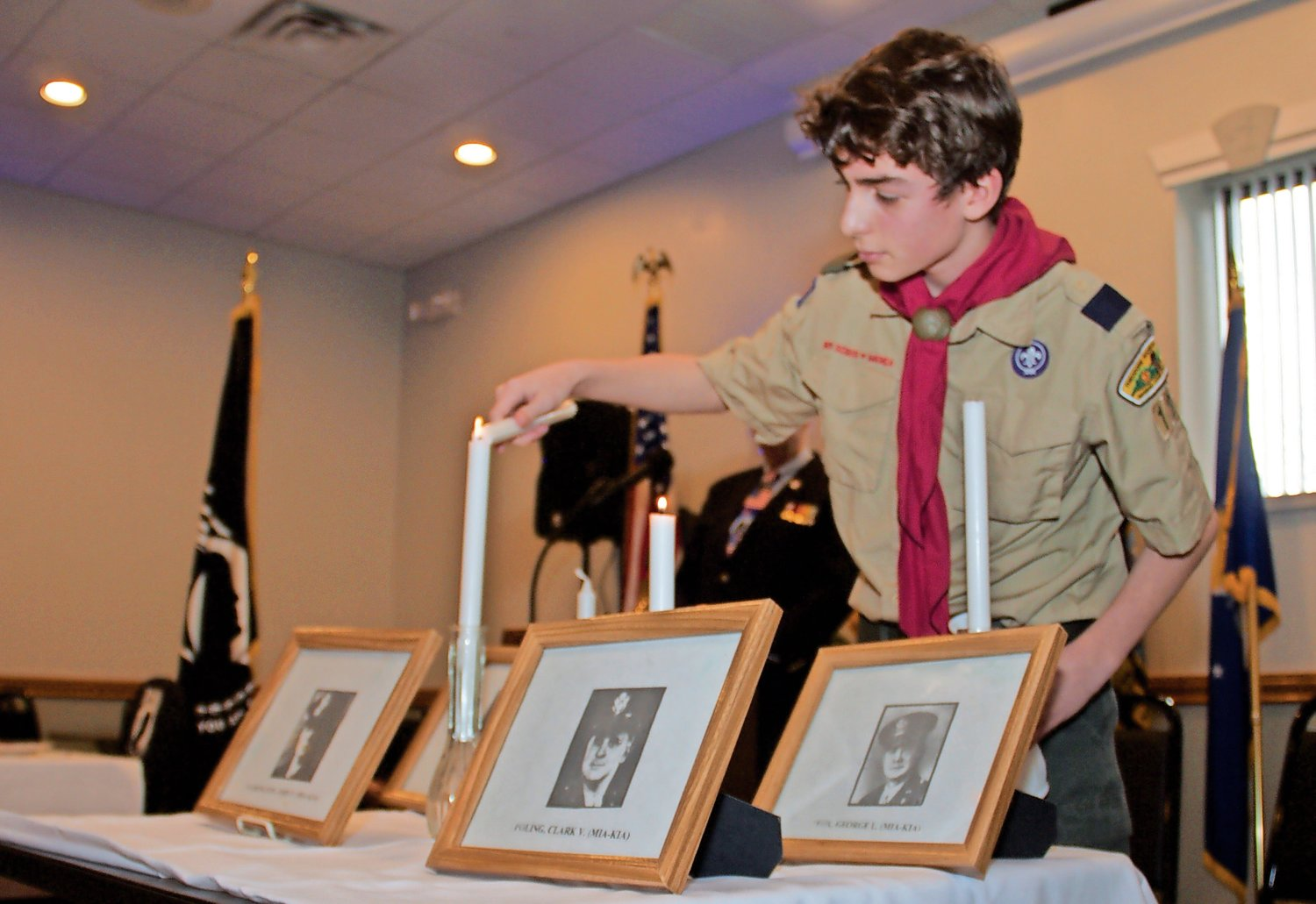 Scout Luke Dixon, of Troop 195, honored the Four Chaplains.